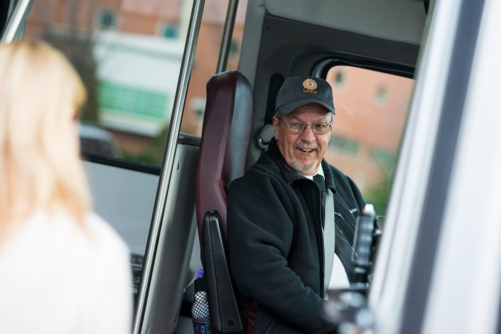 brite bus driver welcoming passengers