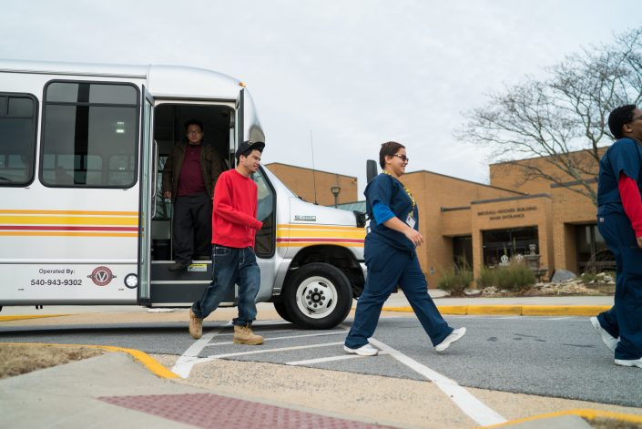 passengers walking off brite bus