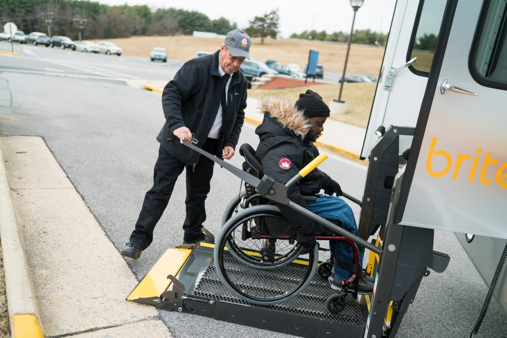 brite bus driver helping passenger with disability