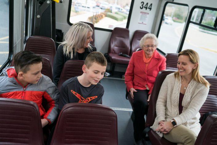 brite bus passengers conversing