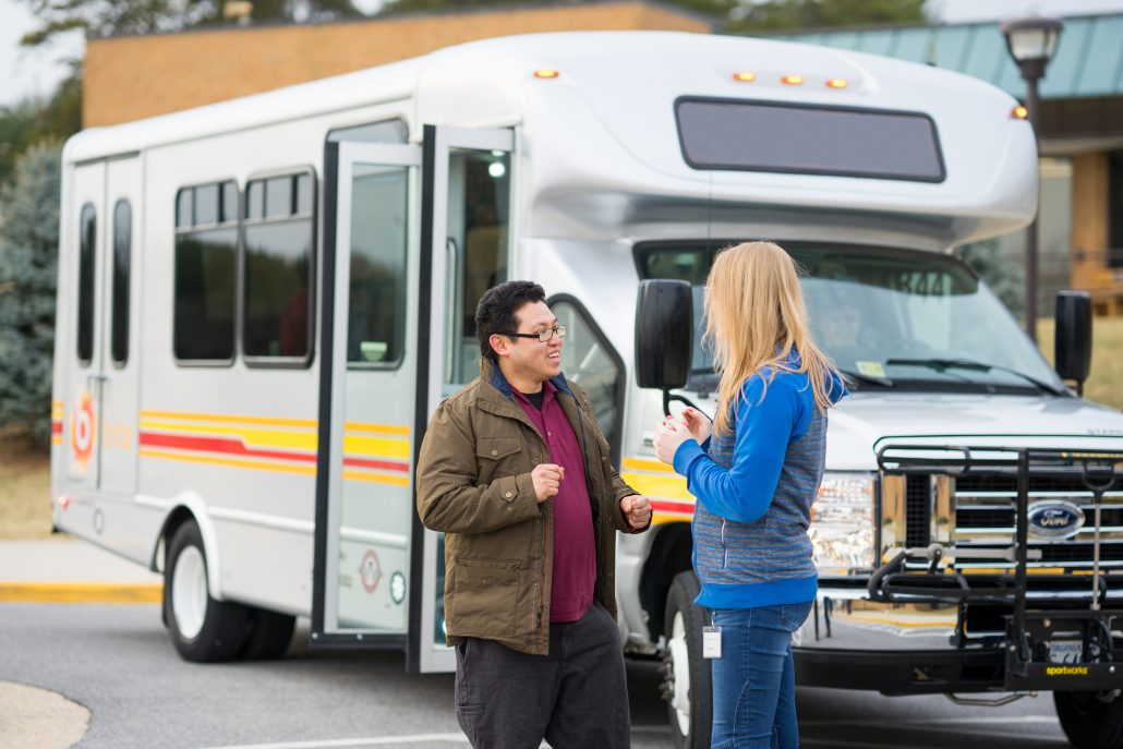 brite bus passengers talking outside of bus