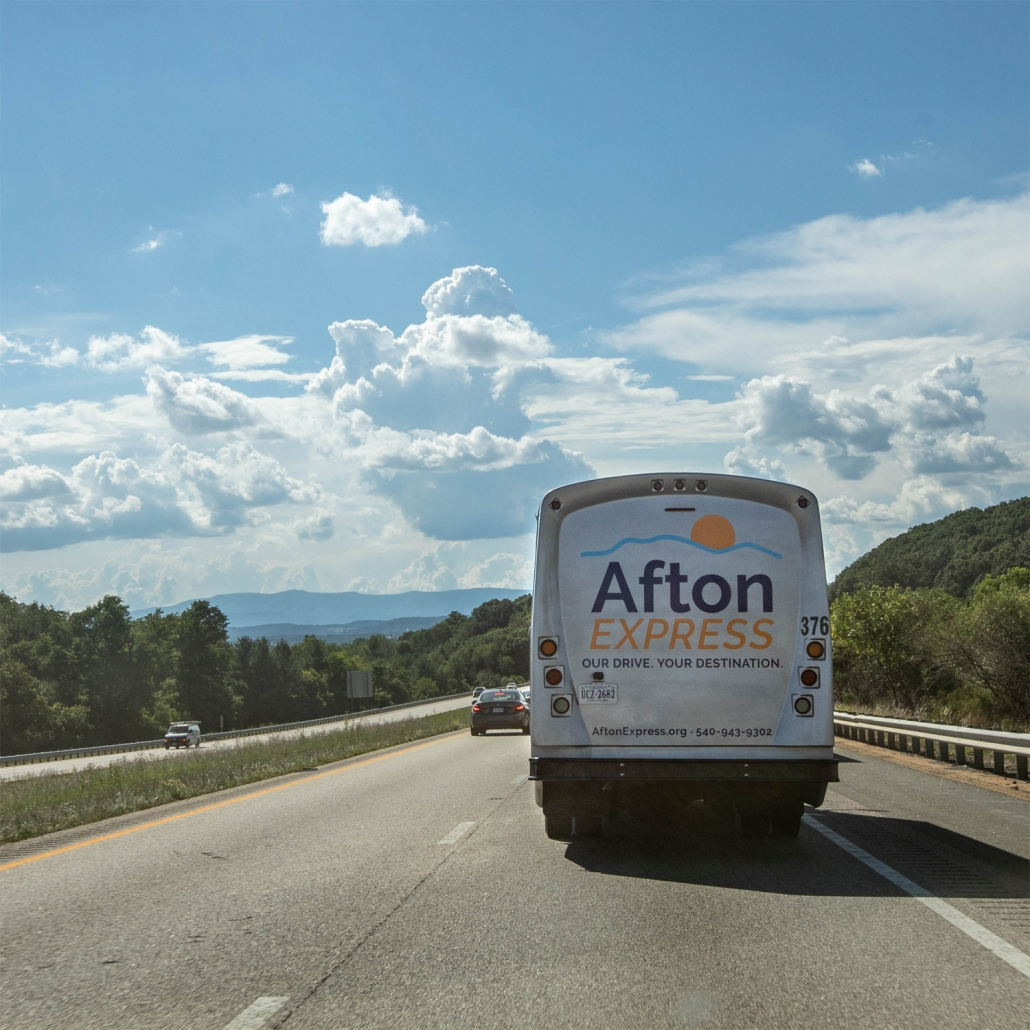 Afton Express bus driving on road